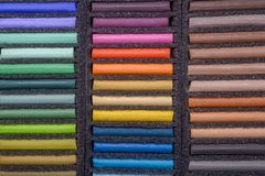 Palette of oil pastels royalty free stock photos
