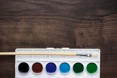 Palette with paint and brush on the table Royalty Free Stock Photography