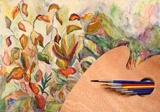 Palette, paint brushes and watercolor scenery Royalty Free Stock Image
