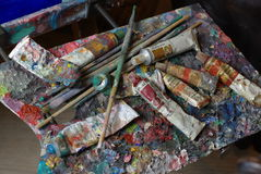 Palette with paint tubes and brusher Stock Photography