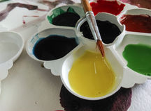 Palette and paintbrush Stock Photos