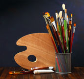 Palette with paintbrushes Royalty Free Stock Photos