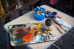 Palette with paintbrush and palette-knife Stock Image