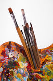Palette with paintbrushes Royalty Free Stock Images