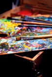 Palette and paintbrushes. Background Stock Image