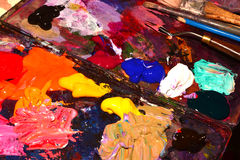 Palette. Paintbrushes and Palette-knife on the palette for mixing oil paints Royalty Free Stock Photos