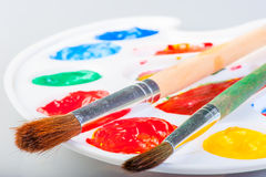 Palette with paints and brushes Royalty Free Stock Photo