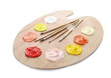 Palette with paints and brushes Stock Images