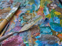 Palette and palette-knife. Artist`s palette and palette-knife Stock Photography