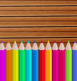 Palette pencils on wooden background Royalty Free Stock Photography