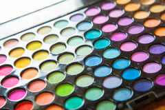 Palette professional colorful eye shadows. Makeup set background. Stock Photography