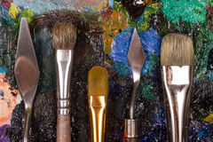 Palette with set of brushes and palette knife. Set of the artist. Painting for design studio , bar or restaurant Royalty Free Stock Photo