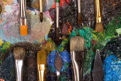 Palette with set of brushes and palette knife. Set of the artist. Painting for design studio , bar or restaurant Royalty Free Stock Image