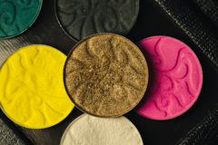 Palette of shadows for make-up with sequins and glitter. white, black, yellow and pink colors.  Royalty Free Stock Photography