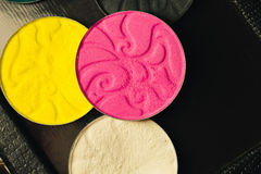Palette of shadows for make-up with sequins and glitter. white, black, yellow and pink colors.  Stock Image