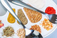 Palette of spices and grains Stock Photo
