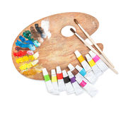 Palette with tubes of paint Royalty Free Stock Photo