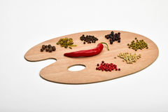 Palette of various spices on wooden palette isolated on white Stock Photo