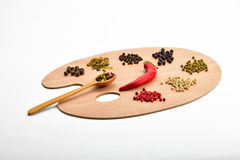 Palette of various spices on wooden palette isolated on white Stock Photos
