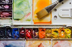 Palette of Water Color and Flat Brush. Water color pigment in the palette and flat brush Stock Image