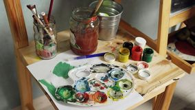 Palette, watercolors and brushes Stock Photo