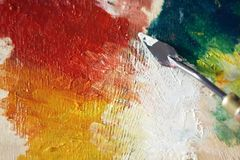 Palette on which a palette knife applied oil paint royalty free stock photo