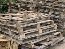 Palettes. Wild stack of used pallets Stock Image