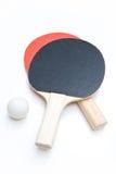 Palettes et bille de ping-pong Photo stock