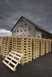Palettes in front of timber mill. Stock of palettes in front of timber mill under the dark sky Stock Images