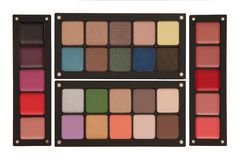 Palettes of lipstick, rouge, and eye shadow stock photography