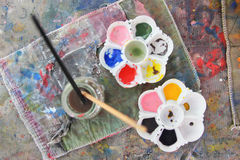 Palettes and paintbrush on table paint Royalty Free Stock Photography
