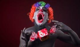 Palhaço assustador com composição assustador e mais doces Imagem de Stock Royalty Free