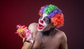Palhaço assustador com composição assustador e mais doces Fotografia de Stock