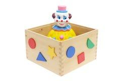 Palhaço do brinquedo na caixa de madeira Fotografia de Stock Royalty Free