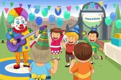 Palhaço em uma festa de anos das crianças ilustração stock