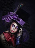 Palhaço no chapéu extravagante do carnaval com composição artística imagem de stock