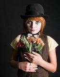 Palhaço triste com flores Fotografia de Stock Royalty Free