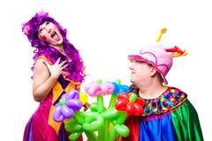 Palhaços Loving com flores coloridas Foto de Stock
