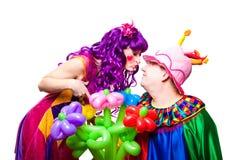 Palhaços Loving com flores coloridas Imagem de Stock