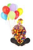 Palhaço com pés e os balões grandes Foto de Stock Royalty Free