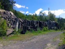 Pali del basalto sulla superficie fotografia stock
