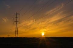 Pali di potere con i cavi Fotografie Stock