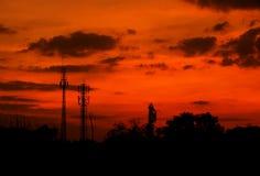 Pali di telefono sul tramonto Fotografia Stock