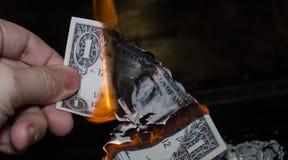 Palić jeden dolara Obrazy Stock
