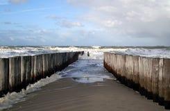 Pali nel mare Fotografia Stock