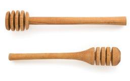 Palillo de madera de la miel en blanco Imagenes de archivo