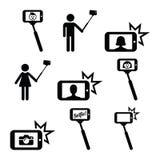Palillo de Selfie con el móvil o iconos del teléfono celular fijados Foto de archivo