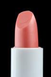 Palillo rosado del cuidado del labio en fondo negro Imagen de archivo