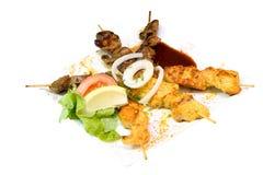 Palillos clasificados del pollo y del cordero Foto de archivo libre de regalías
