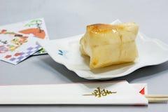 palillos cocidos de la torta y de la celebración de arroz para comer el Año Nuevo japonés Imagen de archivo libre de regalías